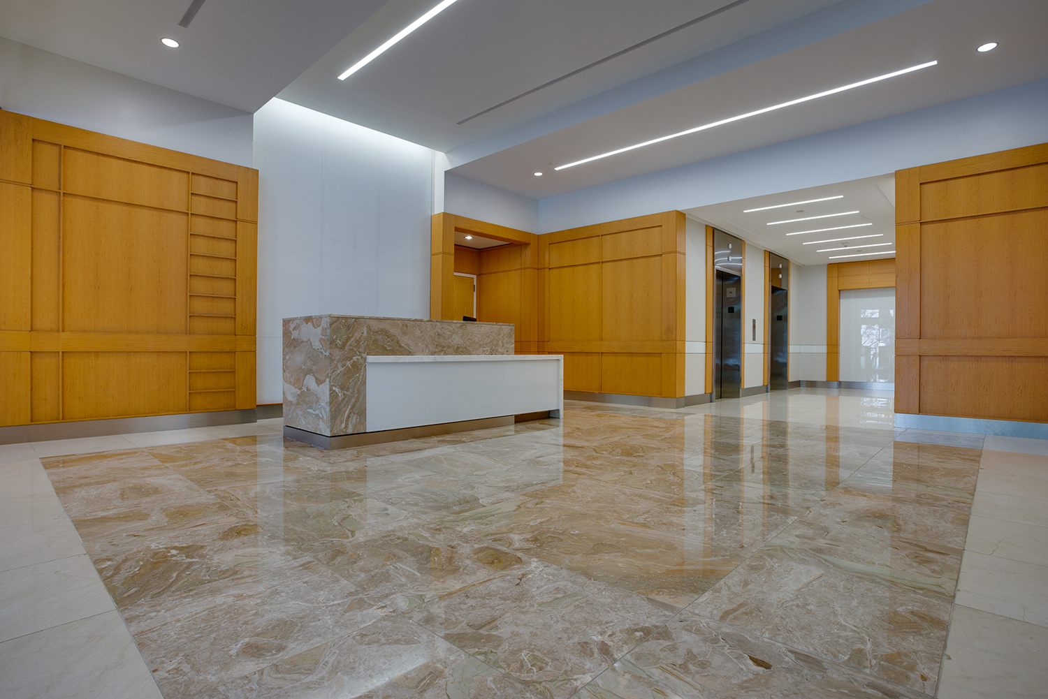 Bethesda Crossing Breccia Oniciata marble flooring and desk