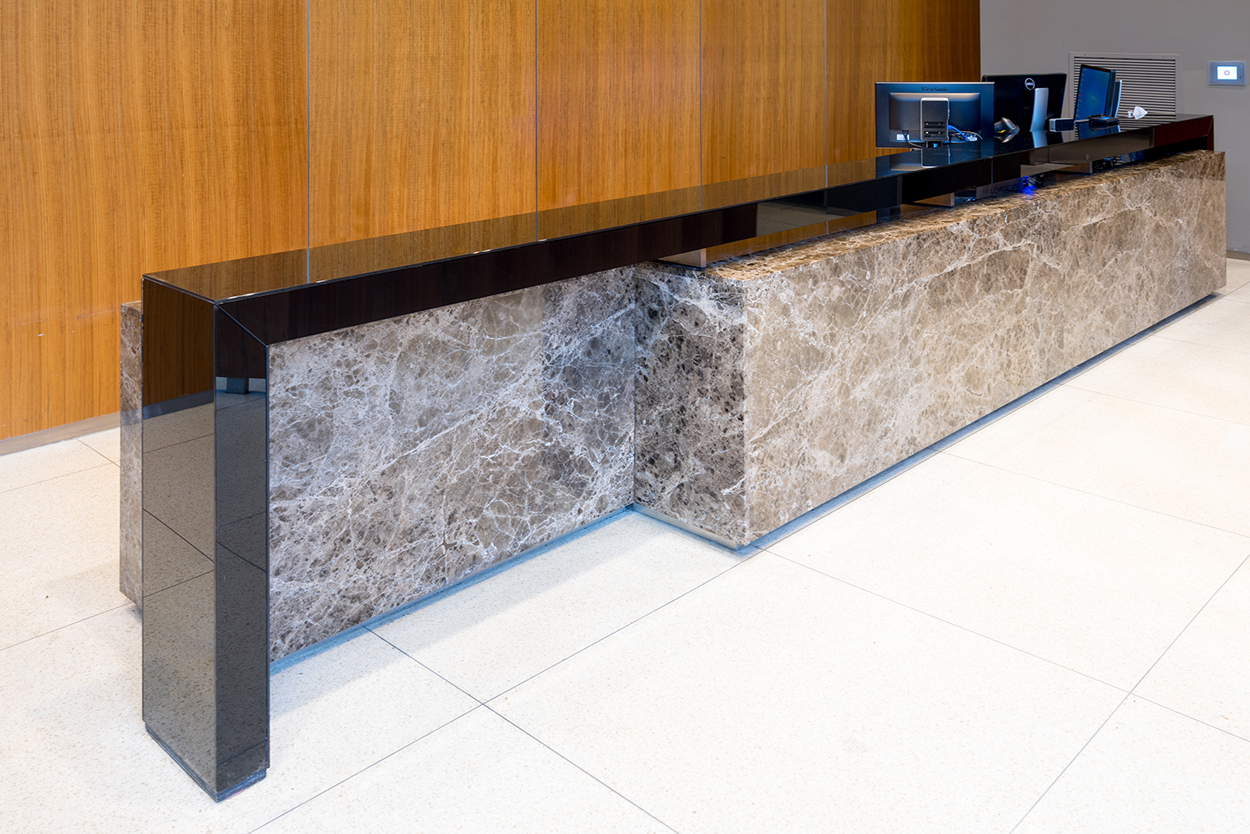 emperador dark marble reception desk